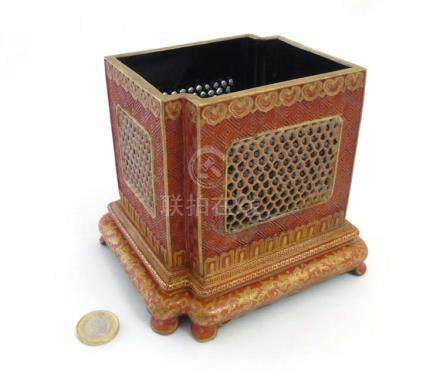 A Chinese burnt orange brush pot with reticulated panels framed by incised meander / Greek key fret