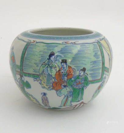 A Chinese Famille Verte vase depicting officials in a pagoda garden scene with Chinese motif to the