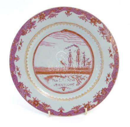 A mid 18th C Chinese Export Dutch puce shipping plate depicting a Dutch vessel at sea with