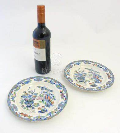 A pair of 19thC Folch & Son plates with blue transfer print oriental style designs and over paint