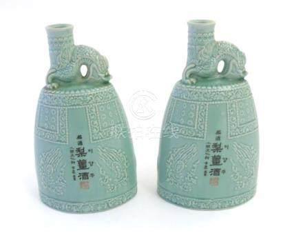 A pair of Korean celadon glaze 'Lee Gang Ju' liqueur bottle flasks with engraved decoration and