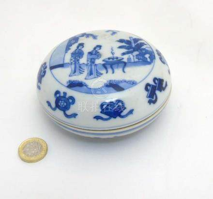 A Chinese blue and white circular ink pot and cover,