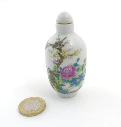 An Oriental Famille Rose snuff bottle depicting a singing birds perched on cherry blossom branches