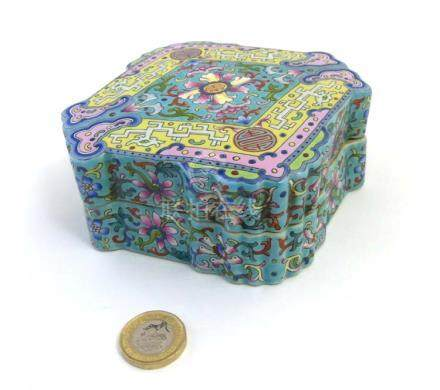 A Chinese Famille Rose turquoise ground lozenge - shaped box and cover,