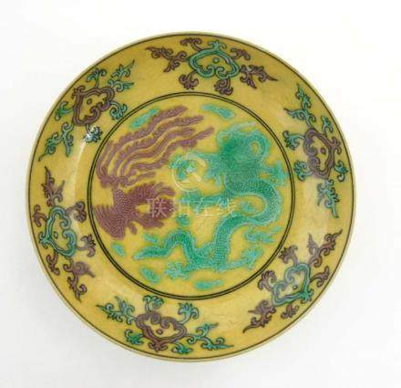 An Imperial yellow '' dragon'' dish , decorated with 5 clawed dragon and a phoenix,
