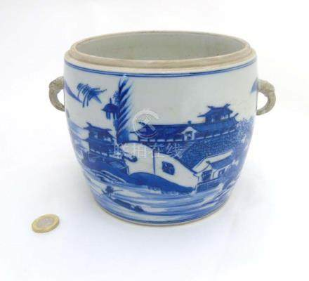A Chinese blue and white jar / pot with handles in the form of snakes,