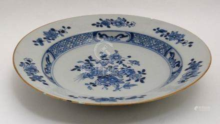 A blue and white Chinese ceramic plate. Decorated with flora in central well and border.