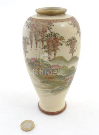 A Japanese Satsuma vase depicting a pagoda garden scene with wisteria decoration along to the top,