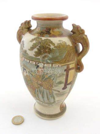 A Japanese Satsuma vase with dragon formed handles,