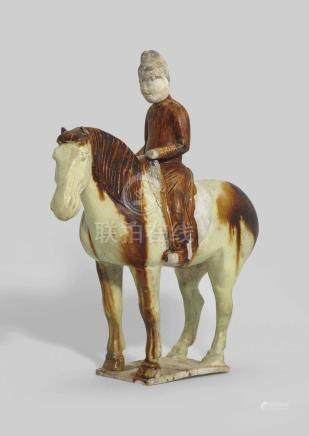 A STRAW AND AMBER-GLAZED POTTERY EQUESTRIAN