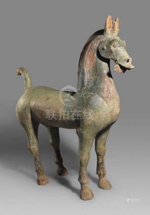 A MASSIVE GREEN-GLAZED POTTERY HORSE