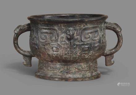 A BRONZE TWIN-HANDLED VESSEL, GUI