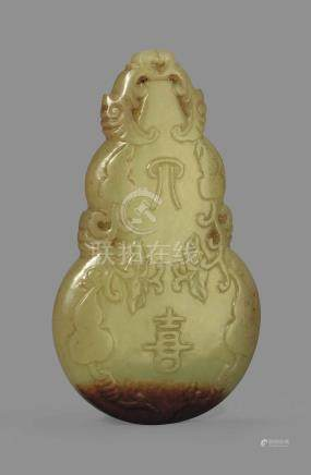 A YELLOW JADE DOUBLE GOURD PENDANT