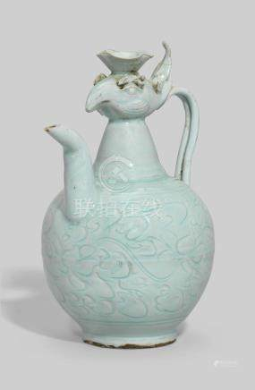 A CARVED QINGBAI-GLAZED 'PHOENIX-HEAD' EWER