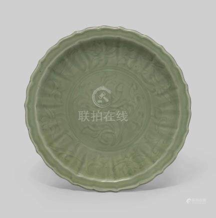 A LONGQUAN CELADON 'LOTUS' BARBED RIM CHARGER