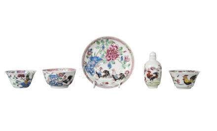 A Chinese porcelain cup and saucer, 18th century, painted in famille rose enamels with two