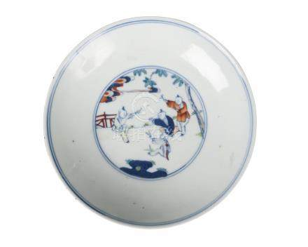 A Chinese porcelain saucer dish, Yongzheng mark, Republic period, painted in underglaze blue and