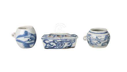 Three Chinese porcelain bird feeders, Qing dynasty, 18th century, each painted in underglaze blue,