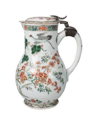 A Chinese porcelain jug and cover, 18th century, painted in famille verte enamels with red-crested
