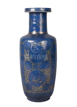 A Chinese porcelain powder blue ground rouleau vase, Kangxi, painted in gilt with two opposing