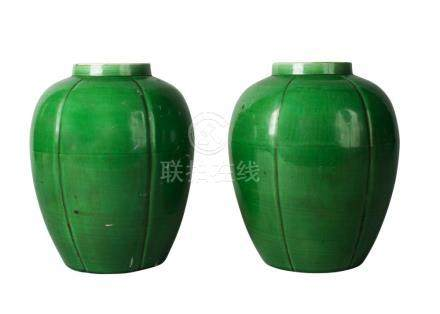 A pair of Chinese monochrome porcelain apple-green glazed lobed jars, Kangxi period, early 18th