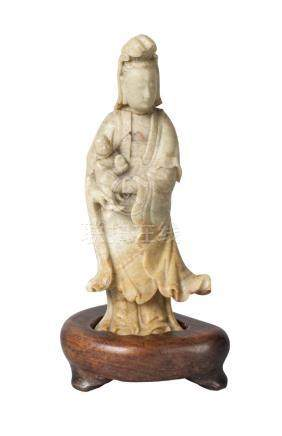 A Chinese soapstone carving of Guanyin and a child, 18th/19th century, carved standing, with cloud-