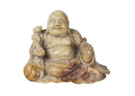 A Chinese soapstone carving of Hotei, 18th/19th century, carved seated, with characteristic