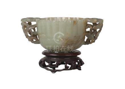 A Chinese green jade twin-handled lobed cup, Ming dynasty, 16th century, with reticulated prunus