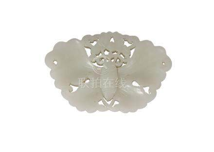 A Chinese pale green jade butterfly plaque, mid-19th century, reticulated, and with wings spread,