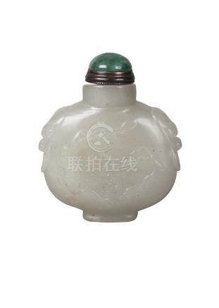A Chinese pale green jade ovoid snuff bottle, late Qing Dynasty, carved in low relief with a chi-