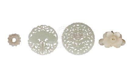 Two Chinese pale green jade circular plaques, 20th century, each carved and pierced with a bat,