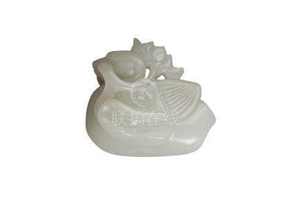 A Chinese Ming-style pale green jade carving of a duck, late Qing Dynasty, carved with a flowering