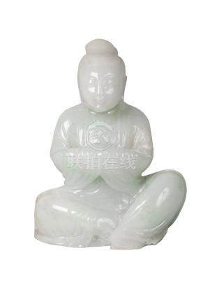 A Chinese jadeite carving of Guanyin, late Qing dynasty, carved seated, with arms folded and