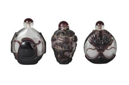 Three Chinese Peking glass cameo large snuff bottles, early 20th century, two of flattened, ovoid