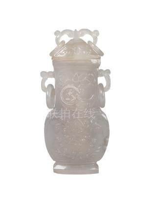 A Chinese agate vase and cover, early 20th century, in the archaic style, the cover and neck with