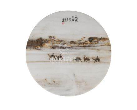 A Chinese 'dream' marble circular plaque, early 20th century, carved to one side in low relief