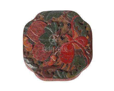 A Chinese cinnabar lacquer canted square box and cover, Qianlong period, carved to the cover with
