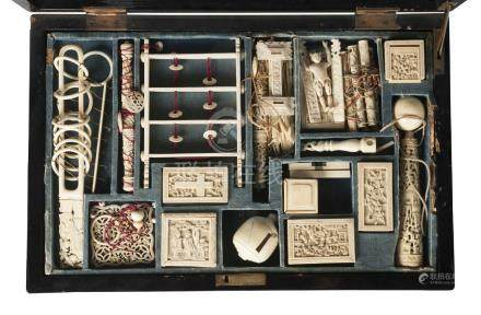 A Chinese Canton ivory puzzle compendium, mid-19th century, comprising various carved ivory