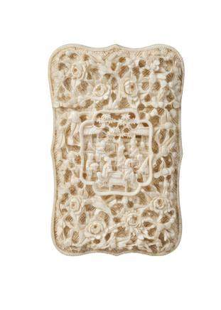 A Chinese Canton ivory card case, mid-19th century, of shaped, rectangular form, carved to both
