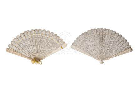 Two Chinese Canton ivory brise fans, mid 19th century, each finely carved with figures in a