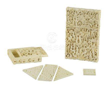 A Chinese Canton ivory puzzle and card case, mid-19th century, carved with figures in landscapes,