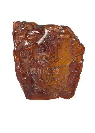 A Chinese amber carving, 19th century, carved with a priest ringing a temple bell in a mountain