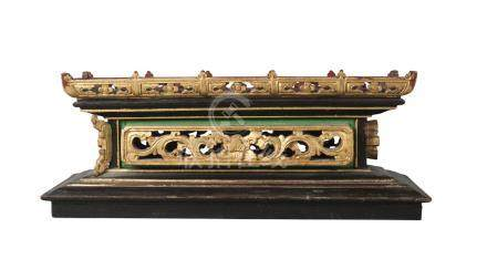 A Chinese lacquered rectangular box, late Qing dynasty, housing a carved wood stand, the case