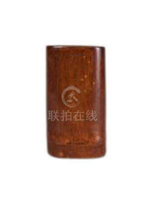 An unusual Chinese bamboo square brush pot, 19th century, of compressed form with rich light patina,