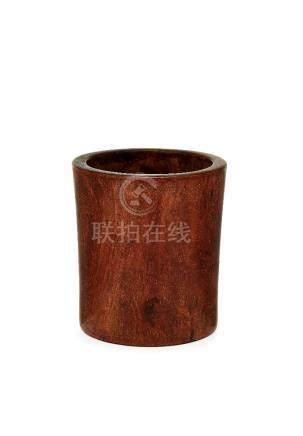 A Chinese hongmu brush pot, 18th century, with rich, light, figured grain, 13cm high one old split