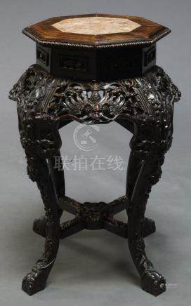A Chinese carved hardwood jardiniere stand, mid-19th century, with octagonal rouge marble inset top,