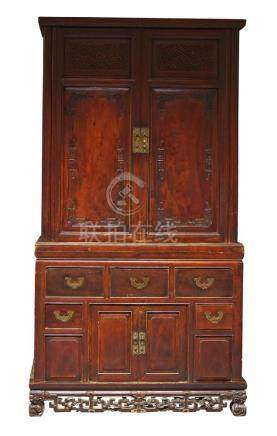 A Chinese hardwood two-section cupboard, late Qing dynasty, the upper section with pair of doors
