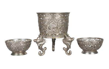 A Chinese silver pierced stand late 19th century/early 20th century, the tapering body pierced