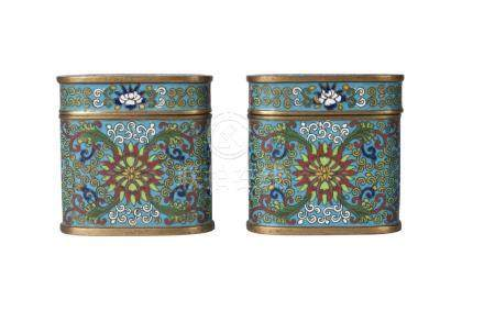 A pair of Chinese cloisonne oval boxes and covers, late Qing dynasty, decorated with lotus blooms