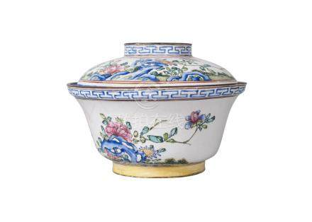 A Chinese Canton painted enamel cup and cover, mid-19th century, painted with blossoming